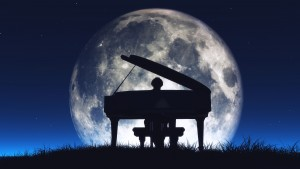 Silhouette of a man playing the piano
